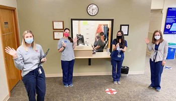 Clinicians and staff in the lobby of the speech and hearing clinic