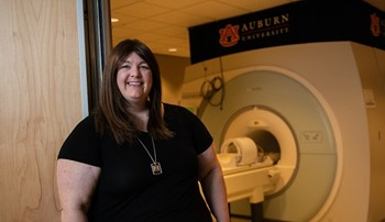 Jennifer Robinson standing in front of MRI machine
