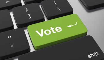 Green Vote key on a computer keyboard